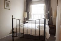 Bedroom at pub with rooms in Bromyard