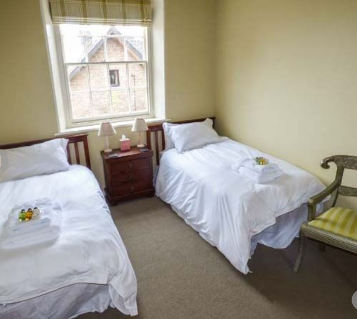 Twin room at large group self catering Bromyard